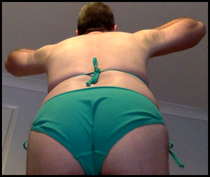 skype cam show snapshot of boy toy in green bikini