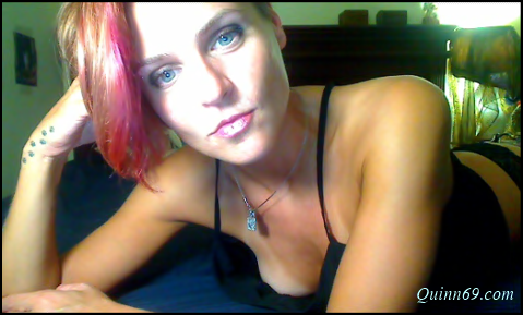 independent camgirl with pink hair posing